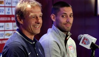 U.S. men's soccer coach Jurgen Klinsmann, left, and World Cup team captain Clint Dempsey answer questions during a news conference, in New York, Friday, May 30, 2014. The U.S. World Cup team is holding a pep rally in Times Square leading to Sunday's exhibition against Turkey, the second of three warmup matches for the Americans before next month's tournament in Brazil. (AP Photo/Richard Drew)