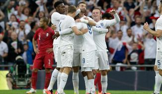 England's Daniel Sturridge, centre celebrates with his teammates after scoring during the international friendly soccer match between England and Peru at Wembley Stadium in London, Friday, May 30, 2014.  (AP Photo/Matt Dunham)