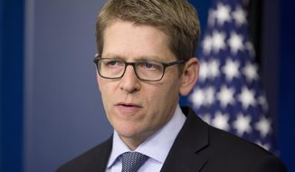 FILE - This May 19, 2014 file photo shows White House Press Secretary Jay Carney listens during his daily news briefing at the White House in Washington.Carney is leaving his post and his No. 2 is taking over.  President Barack Obama announced Carney's departure in a surprise appearance at in the White House press briefing room Friday. He said principal deputy press secretary Josh Earnest will take over the job.  (AP Photo/Pablo Martinez Monsivais, File)