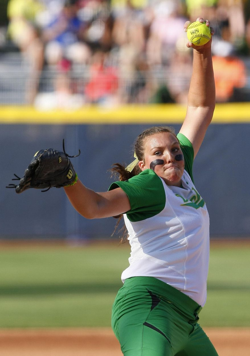 Oregon starter Cheridan Hawkins pitches against Florida during the first inning of an NCAA Women's College World Series softball tournament game in Oklahoma City, Friday, May 30, 2014.  (AP Photo/Alonzo Adams)