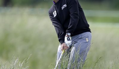 Karrie Webb, of Australia, hits from fescue grass in the rough on the third hole during the first round of the ShopRite LPGA Classic golf tournament in Galloway Township, N.J., Friday, May 30, 2014. (AP Photo/Mel Evans)
