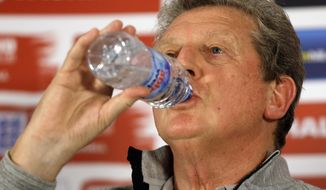 England's soccer team manager Roy Hodgson drinks water at a press conference near Watford, England, Thursday, May 29, 2014. England will play Peru in an international friendly soccer match at Wembley Stadium on Friday. (AP Photo/Kirsty Wigglesworth)