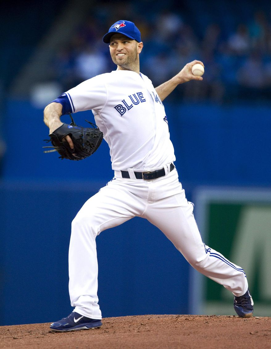 Toronto Blue Jays starting pitcher J.A Happ throws against the Kansas City Royals during the first inning of a baseball game in Toronto on Friday, May 30, 2014. (AP Photo/The Canadian Press, Fred Thornhill)
