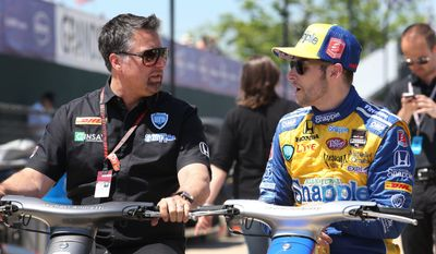 Team owner Michael Andretti, left, talks with driver Marco Andretti after a practice session for the IndyCar Detroit Grand Prix auto race on Belle Isle in Detroit, Friday, May 30, 2014. (AP Photo/Dave Frechette)
