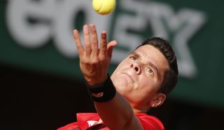 Canada's Milos Raonic serves the ball during the third round match of the French Open tennis tournament against France's Gilles Simon at the Roland Garros stadium, in Paris, France, Friday, May 30, 2014. (AP Photo/Michel Euler)