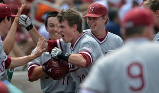 Stanford's Jack Klein, center, is congratulated by teammates after hitting a three-run home run in the sixth inning of an NCAA college regional baseball game against Indiana State, Friday, May 30, 2014, in Bloomington, Ind. (AP Photo/Tribune-Star, Joseph C. Garza)