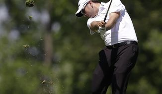 Ben Curtis hits from the ninth fairway during the second round of the Memorial golf tournament Friday, May 30, 2014, in Dublin, Ohio. (AP Photo/Darron Cummings)