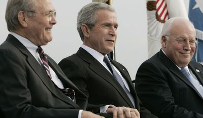 **FILE** President Bush (center), Vice President Dick Cheney (right) and outgoing Defense Secretary Donald H. Rumsfeld take part in an Armed Forces Full Honor Review for Rumsfeld on Dec. 15, 2006 at the Pentagon. (Associated Press)