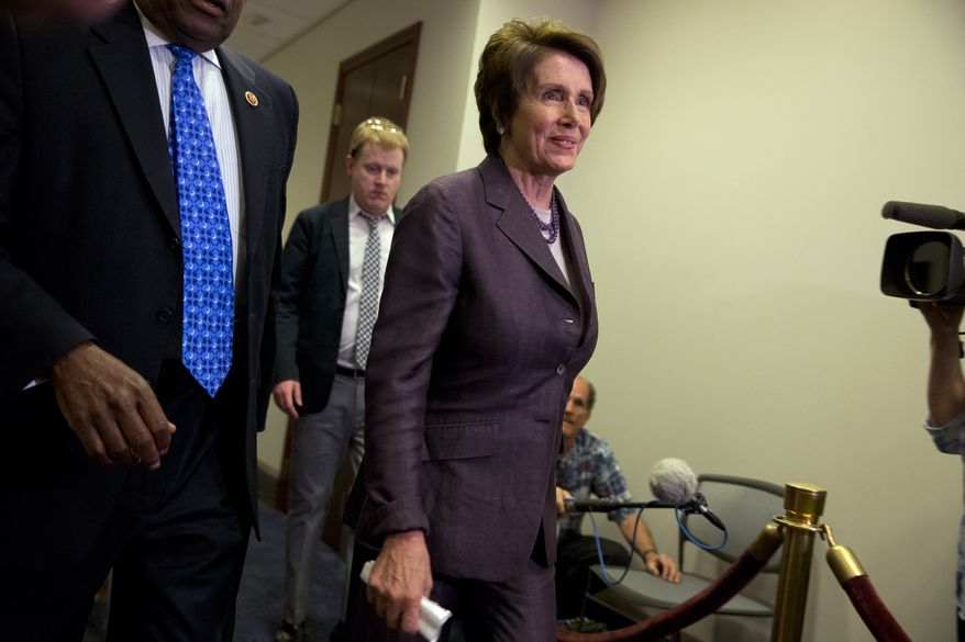 **FILE** House Minority Leader Nancy Pelosi, California Democrat, arrives May 9, 2014, for a House Democratic caucus on Capitol Hill in Washington. (Associated Press)