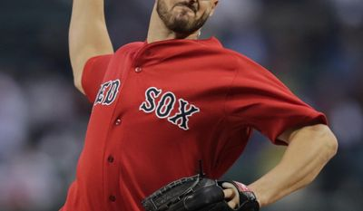 Boston Red Sox starting pitcher Brandon Workman delivers against the Tampa Bay Rays during the first inning of a baseball game at Fenway Park in Boston, Friday, May 30, 2014. (AP Photo/Charles Krupa)