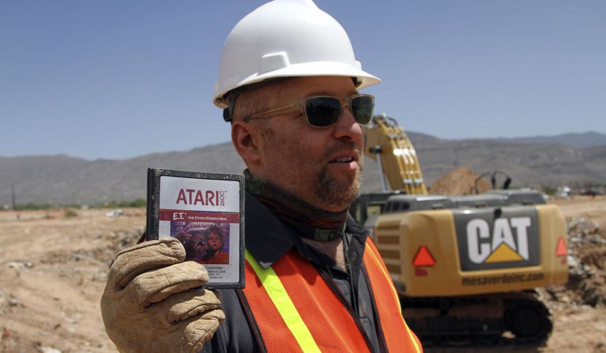 "Film Director Zak Penn shows a box of a decades-old Atari ""E.T. the Extra-Terrestrial"" game found in a dumpsite in Alamogordo, N.M., in this April 26, 2014, file photo, Producers of a documentary dug in an southeastern New Mexico landfill in search of millions of cartridges of the Atari ""E.T. the Extra-Terrestrial"" game that has been called the worst game in the history of video gaming and were buried there in 1983. (AP Photo/Juan Carlos Llorca)"
