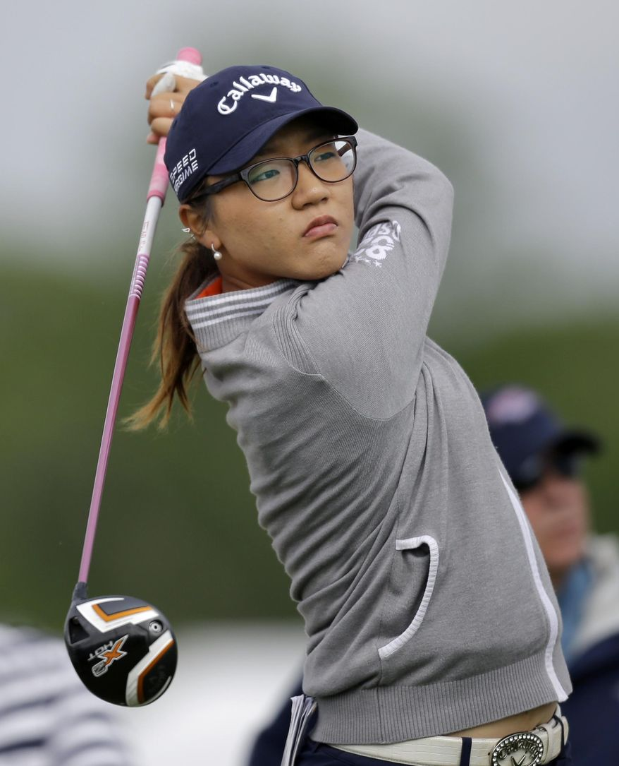 Lydia Ko, of New Zealand, watches her tee shot on the fourth hole during the first round of the ShopRite LPGA Classic golf tournament in Galloway Township, N.J., Friday, May 30, 2014. (AP Photo/Mel Evans)