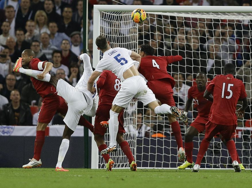 England's Gary Cahill, number 5, scores a goal during the international friendly soccer match between England and Peru at Wembley Stadium in London, Friday, May 30, 2014. (AP Photo/Kirsty Wigglesworth)