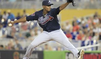 Atlanta Braves starting pitcher Julio Teheran throws against the Miami Marlins in the first inning during their baseball game in Miami, Friday, May 30, 2014. (AP Photo/Joe Skipper)