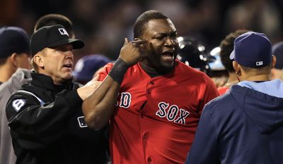 Boston Red Sox designated hitter David Ortiz is held back by umpire Jeff Kellogg after benches cleared after Tampa Bay Rays starting pitcher David Price hit Mike Carp with a pitch during the fourth inning of a baseball game at Fenway Park in Boston, Friday, May 30, 2014. (AP Photo/Charles Krupa)