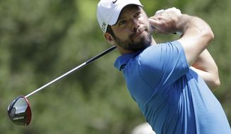 Paul Casey tees off on the 15th hole during the second round of the Memorial golf tournament Friday, May 30, 2014, in Dublin, Ohio. (AP Photo/Jay LaPrete)