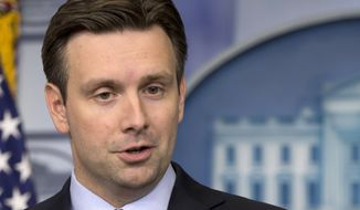 FILE - This April 4, 2014 file photo shows White House deputy press secretary Josh Earnest speaking during the daily news briefing at the White House in Washington. (AP Photo/Carolyn Kaster, File)