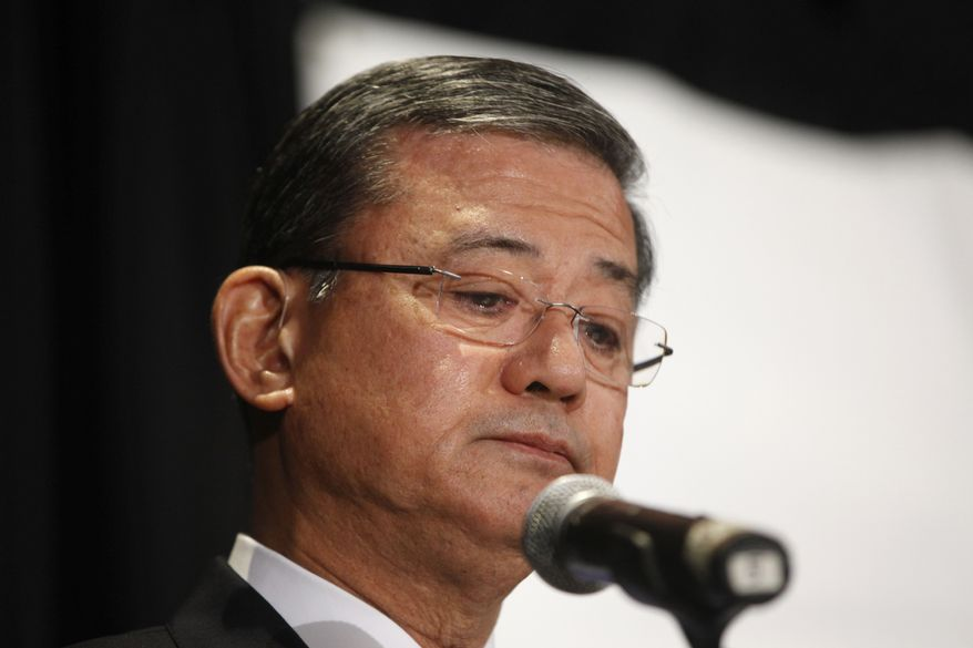 "Veterans Affairs Secretary Eric Shinseki pauses as he speaks at a meeting of the National Coalition for Homeless Veterans, Friday, May 30, 2014, in Washington. President Barack Obama says he plans to have a ""serious conversation"" with Shinseki about whether he can stay in his job.  (AP Photo/Charles Dharapak)"