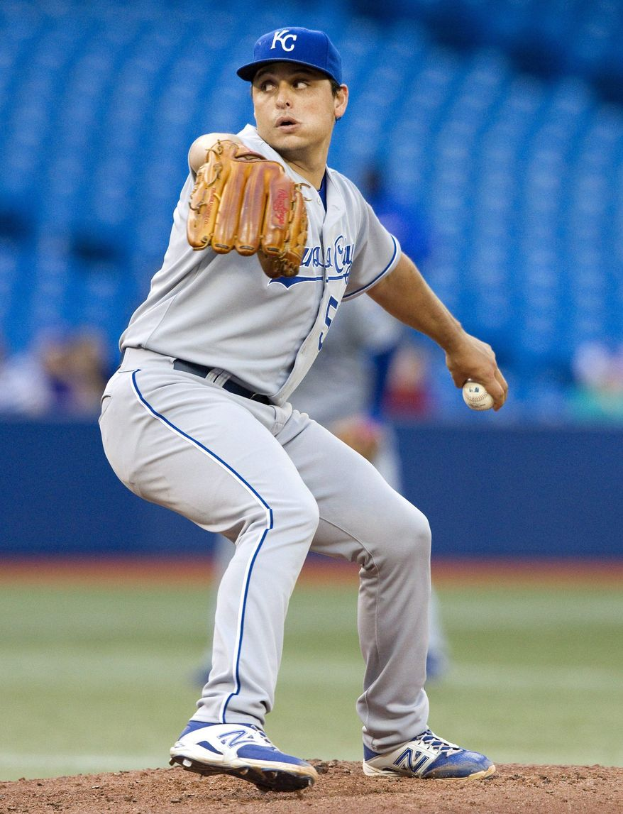 Kansas City Royals starting pitcher Jason Vargas throws to a Toronto Blue Jays batter during the third inning of a baseball game in Toronto on Friday, May 30, 2014. (AP Photo/The Canadian Press, Fred Thornhill)