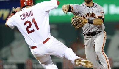 San Francisco Giants' Brandon Hicks, right, forces out St. Louis Cardinals' Allen Craig (21) and completes the double play as Cardinals' Jhonny Peralta is out at first in the fourth inning in a baseball game on Friday, May 30, 2014, at Busch Stadium in St. Louis. (AP Photo/Bill Boyce)