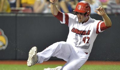 Louisville's Jeff Gardner slides in to score in the third inning during an NCAA college baseball regional tournament game against Kent State in Louisville, Ky., Friday, May 30, 2014. (AP Photo/Timothy D. Easley)