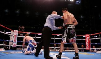 George Groves, left, is knocked down by Carl Froch during their IBF and WBA World Super Middleweight Title fight at Wembley Stadium in London, Saturday May 31, 2014. (AP Photo / Peter Byrne, PA) UNITED KINGDOM OUT - NO SALES - NO ARCHIVES