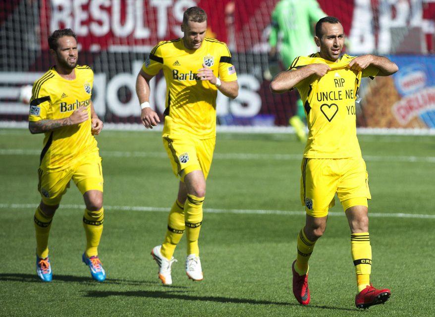 Columbus Crew midfielder Dominic Oduro, right, celebrates his goal against Toronto FC during the first half of an MLS soccer game in Toronto on Saturday, May 31, 2014. (AP Photo/The Canadian Press, Nathan Denette)
