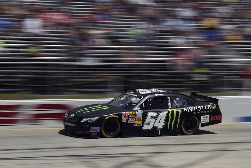 In this image taken with a slow shutter speed, Kyle Busch races during the NASCAR Nationwide series auto race, Saturday, May 31, 2014, at Dover International Speedway in Dover, Del. (AP Photo/Molly Riley)