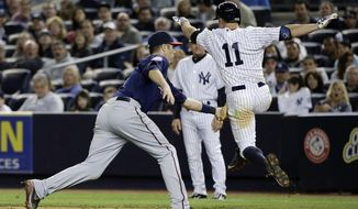 Minnesota Twins first baseman Joe Mauer, left, tags out New York Yankees' Brett Gardner (11) as Gardner sprints down the first baseline on a ground ball during the eighth inning on Friday, May 30, 2014, in New York. The Twins won 6-1. (AP Photo/Julie Jacobson)