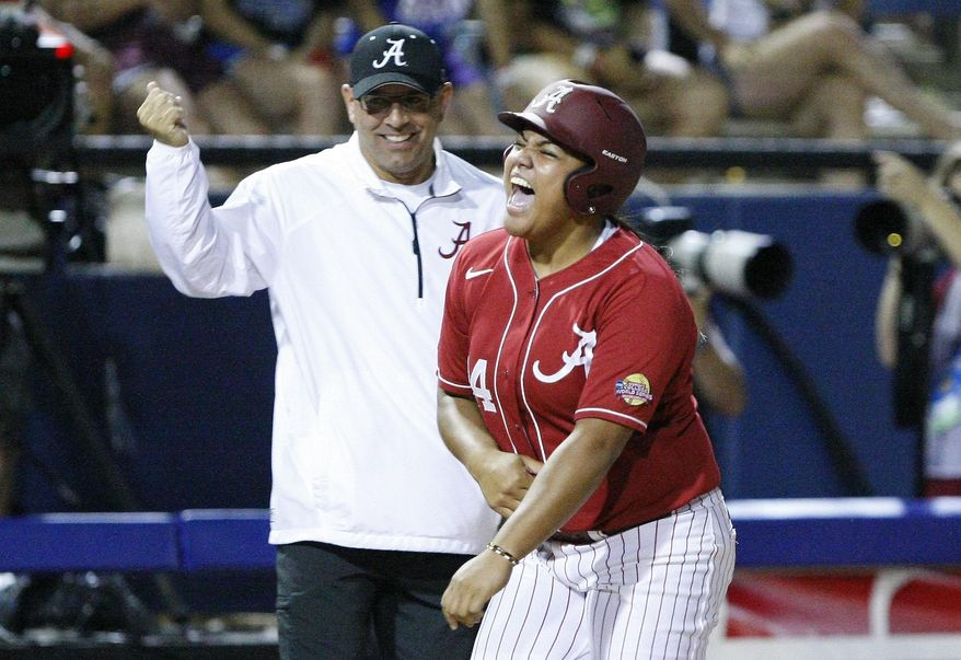Alabama's Leona Lafaele celebrates on her way to home plate after hitting a two-run home run against Kentucky during the second inning of an NCAA Women's College World Series softball tournament game in Oklahoma City, Friday, May 30, 2014. (AP Photo/Alonzo Adams)