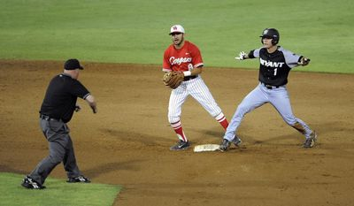 Bryant's Carl Anderson (1) and Houston second baseman Josh Vidales (8) look for the call at second during an NCAA college baseball tournament regional game in Baton Rouge, La., Friday, May 30, 2014. Anderson was out on the play. (AP Photo/Stacy Revere)