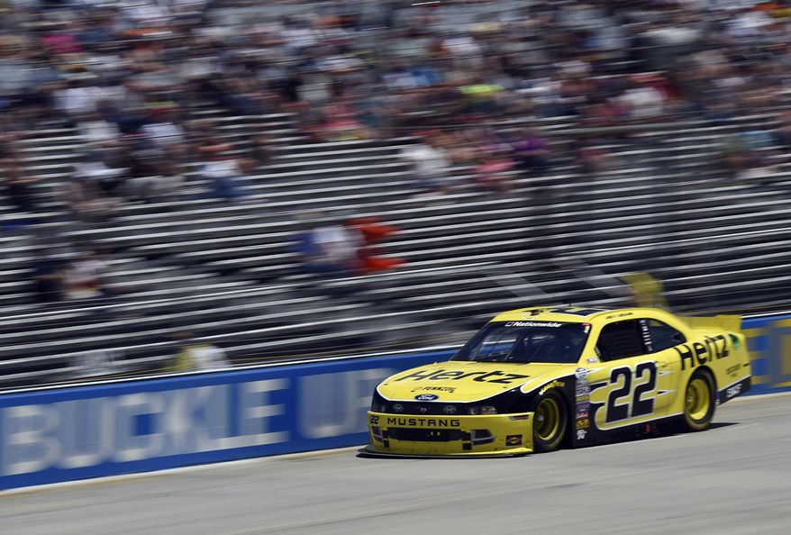 In this image taken with a slow shutter speed, Joey Logano races during the NASCAR Nationwide series auto race, Saturday, May 31, 2014, at Dover International Speedway in Dover, Del. (AP Photo/Molly Riley)