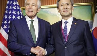 U.S. Defense Secretary Chuck Hagel, left, meets with South Korean Defense Minister Kim Kwan-jin, right, Saturday, May 31, 2014 in Singapore. Hagel traveled to Singapore to attend the 13th Asia Security Summit. (AP Photo/Pablo Martinez Monsivais, Pool)