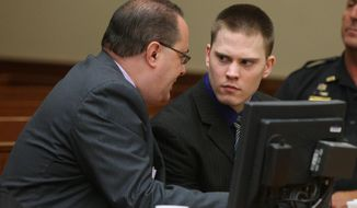 Attorney John Leonard talks with is client Clayton Whittemore during closing arguments Thursday, May 29, 2014, in Rochester, N.Y. The 22-year-old Whittemore was charged in the September 2012 beating death of 18-year-old girlfriend Alexandra Kogut inside her dorm room at the State University of New York College at Brockport, 15 miles west of Rochester. (AP Photo/Democrat & Chronicle, Jamie Germano)  MAGS OUT; NO SALES