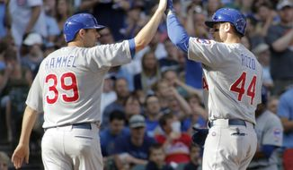 Chicago Cubs' Anthony Rizzo, right, is congratulated by Chicago Cubs' Jason Hammel, left, after hitting a two-run home run against the Milwaukee Brewers during the sixth inning of a baseball game Saturday, May 31, 2014, in Milwaukee. (AP Photo/Darren Hauck)