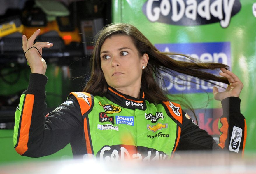 Danica Patrick adjusts her hair before practice for the NASCAR Sprint Cup series auto race, Saturday, May 31, 2014, at Dover International Speedway in Dover, Del. (AP Photo/Nick Wass)