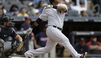 New York Yankees' Yangervis Solarte follows through with a home run during the fourth inning of a baseball game against the Minnesota Twins Saturday, May 31, 2014, in New York.  (AP Photo/Frank Franklin II)