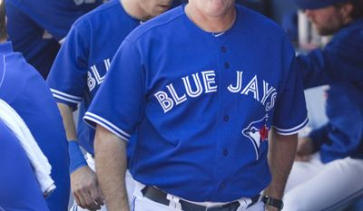 Toronto Blue Jays hitting coach Kevin Seitzer walks in the dugout during a baseball game against the Kansas City Royals in Toronto, Saturday, May 31, 2014. (AP Photo/The Canadian Press, Fred Thornhill)