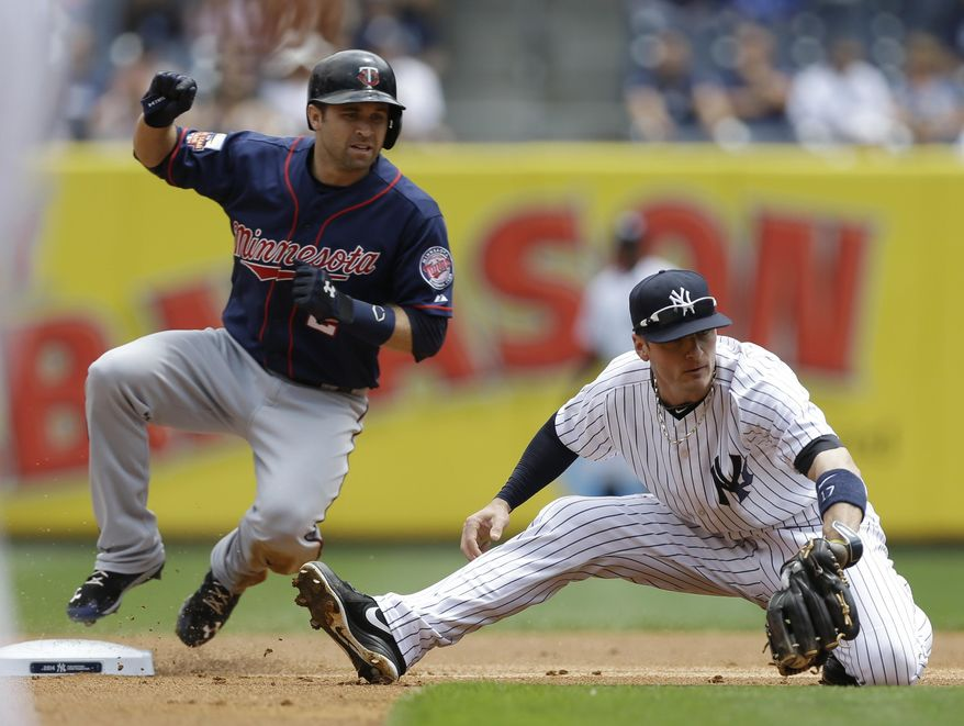 Minnesota Twins' Brian Dozier (2) slides past New York Yankees shortstop Brendan Ryan to steal second base during the first inning of a baseball game Saturday, May 31, 2014, in New York.  (AP Photo/Frank Franklin II)