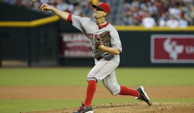 Cincinnati Reds pitcher Mike Leake throws against the Arizona Diamondbacks during the third inning of a baseball game, Friday, May 30, 2014, in Phoenix. (AP Photo/Matt York)