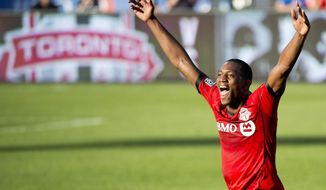 Toronto FC defender Doneil Henry reacts at game end after scoring the game winning goal against the Columbus Crew during second half MLS soccer action in Toronto on Saturday May 31, 2014. (AP Photo/The Canadian Press, Nathan Denette)