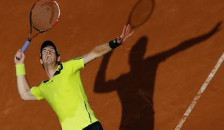Britain's Andy Murray serves to Germany's Philipp Kohlschreiber during their third round match of  the French Open tennis tournament at the Roland Garros stadium, in Paris, France, Saturday, May 31, 2014. (AP Photo/David Vincent)