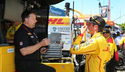 Michael Andretti, left, talks with driver Ryan Hunter-Reay after a practice session for the IndyCar Detroit Grand Prix auto race on Belle Isle in Detroit, Friday, May 30, 2014 in Detroit, Friday, May 30, 2014. (AP Photo/Bob Brodbeck)