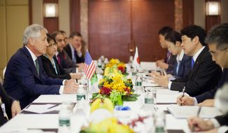 U.S. Defense Secretary Chuck Hagel, left, listens to Japanese Defense Minister Itsunori Onodera, right, at the start of their meeting Saturday, May 31, 2014 in Singapore. Hagel traveled to Singapore to attend the 13th Asia Security Summit. (AP Photo/Pablo Martinez Monsivais, Pool)