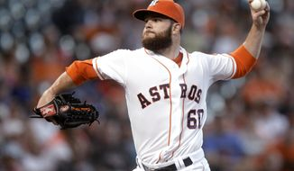 Houston Astros pitcher Dallas Keuchel throws during the second inning of a baseball game against the Baltimore Orioles, Saturday, May 31, 2014, in Houston. (AP Photo/Patric Schneider)