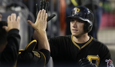 Pittsburgh Pirates' Clint Barmes, right, is greeted by teammates after he scored on a single by Neil Walker during the third inning of a baseball game against the Los Angeles Dodgers on Friday, May 30, 2014, in Los Angeles. (AP Photo/Jae C. Hong)