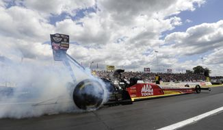 In this photo provided by NHRA, Top Fuel driver Doug Kalitta secures the No. 1 qualifying position in his Mac Tools dragster at the 45th annual Toyota NHRA Summernationals Saturday, May 31, 2014, at Old Bridge Township Raceway Park in Englishtown, N.J. (AP Photo/NHRA, Marc Gewertz)