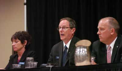 Jefferson County District Attorney Susan Happ, from left, Rep. Jon Richards and Waukesha County DA Brad Schimel, attend the Wisconsin Professional Police Association annual meeting Saturday, May 31, 2014, in Wisconsin Dells, Wis. (AP Photo/Taylor W Anderson)