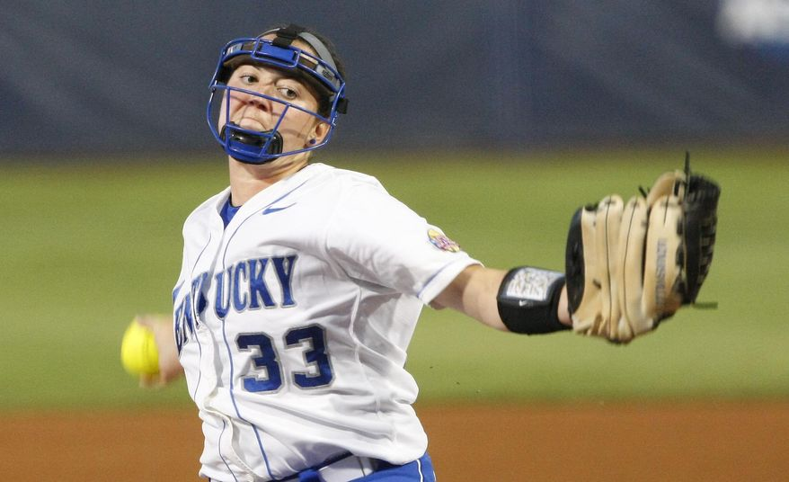 Kentucky starter Kelsey Nunley pitches against Alabama during the first inning of an NCAA Women's College World Series softball tournament game in Oklahoma City, Friday, May 30, 2014.  (AP Photo/Alonzo Adams)