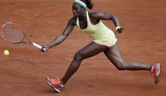 Sloane Stephens of the U.S. returns the ball during the third round match of the French Open tennis tournament against Russia's Ekaterina Makarova at the Roland Garros stadium, in Paris, France, Saturday, May 31, 2014. Stephens won in two sets 6-3, 6-4. (AP Photo/David Vincent)